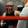 Tawnia Wormell, 42, throws a punch at Rachel Griego in her first professional fight.<br /> Cliff Grassmick / November 12, 2009