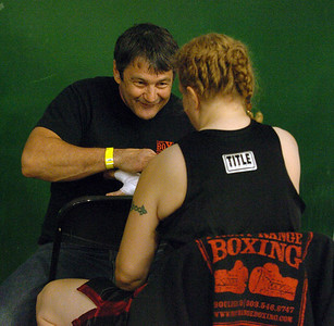 Trainer Dave Gaudette wraps Tawnia's hands before her first fight in Denver. Cliff Grassmick / November 12, 2009