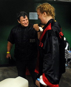 Trainer Dave Gaudette celebrates Tawnia's win in her first professional fight. Cliff Grassmick / November 12, 2009