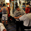 Tawnia Wormell, far left, prepsChris Johnson before a workout at Front Range Boxing Academy. Trainer  Dave Gaudette works with Oscar Martinez on the right.<br /> Cliff Grassmick / November 12, 2009
