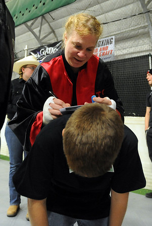 Tawnia Wormell signs an autograph for a young fan after her first professional fight.<br /> Cliff Grassmick / November 12, 2009