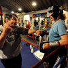 Trainer Dave Gaudette tells Tawnia Wormell where her hands should be during instruction at the Front Range Boxing Academy.<br /> Cliff Grassmick / November 12, 2009