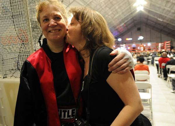 Over 50 friends and family came to see Tawnia Wormell box for the first time. It turned out to be a win in three rounds. Her sister Monee Rochelle-Swartz gives her a kiss after the win.<br /> Cliff Grassmick / November 12, 2009