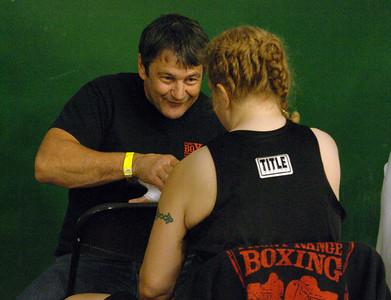 Trainer Dave Gaudette of Boulder  wraps Tawnia's hands before her first fight in Denver. Cliff Grassmick / November 12, 2009