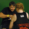 Trainer Dave Gaudette of Boulder  wraps Tawnia's hands before her first fight in Denver.<br /> Cliff Grassmick / November 12, 2009