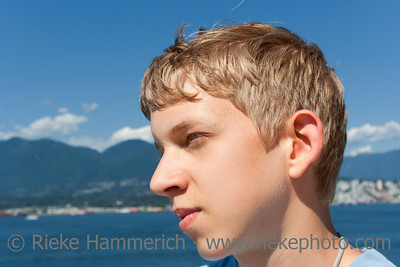 Teenage Boy Portrait - In front of Sea, Mountains and blue Sky