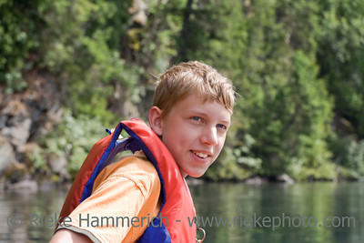 Happy teenage boy canoeing - Clearwater Lake, Wells Gray Provincial Park, British Columbia, Canada