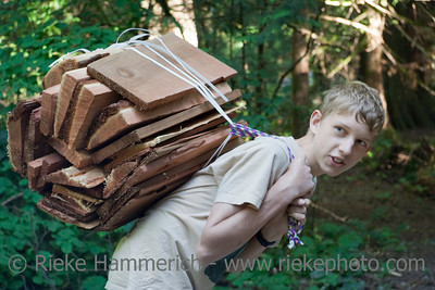Boy carrying Firewood – Vancouver Island, British Columbia, Canada