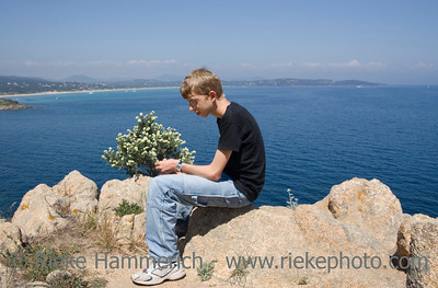teen sitting on rocks - gulf of saint-tropez, French Riviera - adobe RGB