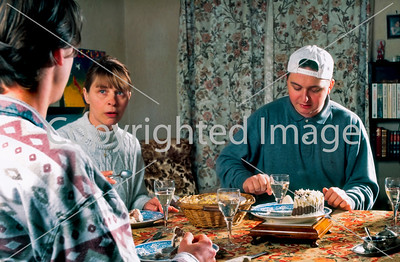 Paris, France, French Family with Two Sons and Mother,  Sharing Dinner Together in the Dining Room at Home.