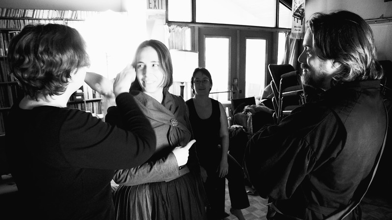 Costumer Adrienne Dandy tidies Kate's (Polly Edwards) hair as Director Anita Kilgour and Petruchio (Nick Oddson) look on.
