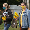 Second last Tuesday Tewksbury Community Market, at the field across from the Tewksbury Public Library. The last market will be Tuesday, Sept. 22, 4-7pm. Kelley Ciampa, left, and her daughter Erin Ciampa, 18, both of Tewksbury, bought their sunflowers at the Tewksbury Public Library Community Garden booth. (SUN/Julia Malakie)