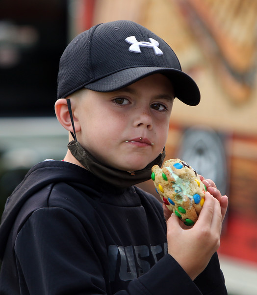 Second last Tuesday Tewksbury Community Market, at the field across from the Tewksbury Public Library. The last market will be Tuesday, Sept. 22, 4-7pm. Tyler Richardson, 7, of Tewksbury, eats a cookie & ice cream sandwich from the very popular Cookie Monstah truck. (SUN/Julia Malakie)