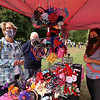 Second last Tuesday Tewksbury Community Market, at the field across from the Tewksbury Public Library. The last market will be Tuesday, Sept. 22, 4-7pm. Donna and husband Joe Gill of Tewksbury shop for headbands for their great-nieces at the KC Styles booth. Kristen Tomassetti of Tewksbury, right, is the owner. (SUN/Julia Malakie)