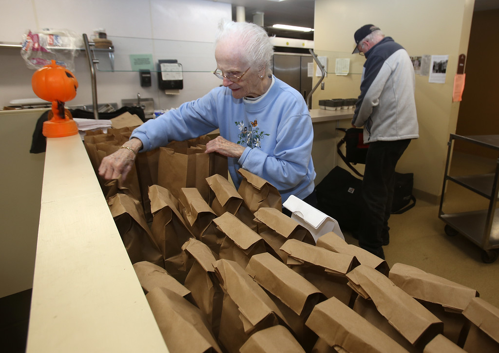 . Tewksbury Meals on Wheels volunteers prepare lunches foinger Volunteers Ginger MacLean, lefd, and Ron Fritz, both of Tewksbury. (SUN/Julia Malakie)