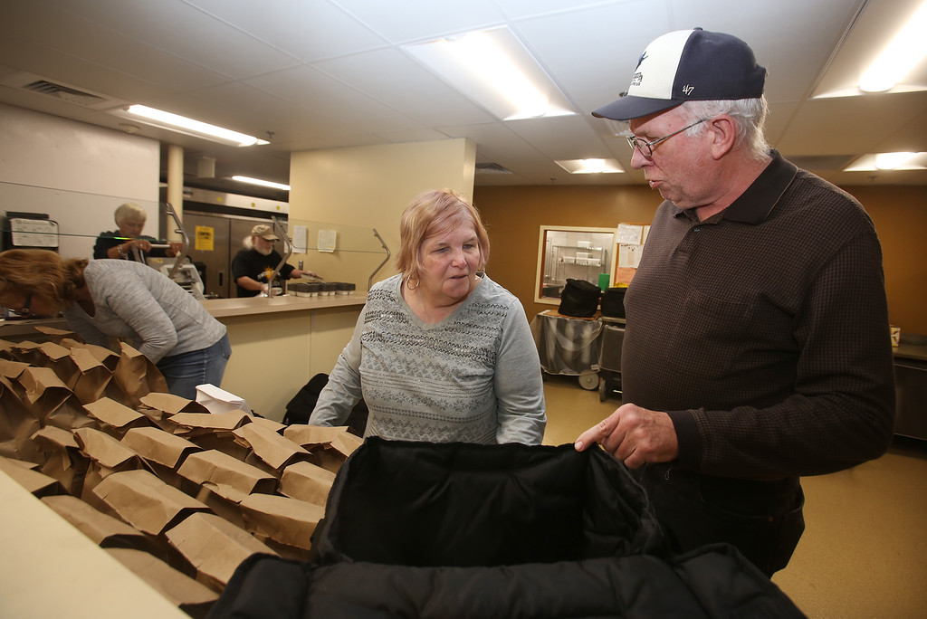 . Tewksbury Meals on Wheels volunteers prepare lunches for delivery, at the Tewksbury Senior Center. Jean and husband Ron Fritz of Tewksbury, who do deliveries together. (SUN/Julia Malakie)