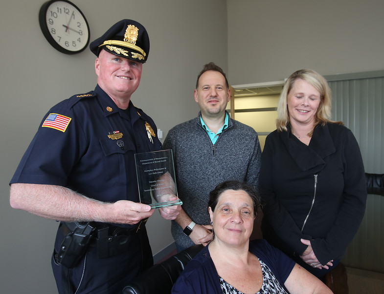 Clockwise from left, Tewksbury police chief Tim Sheehan; co-response clinician Matt Page-Shelton; family service officer Kimberly O'Keefe; and Maria Ruggiero, program director, Substance Abuse Prevention Collaborative, with the Commonwealth of Massachusetts Department of Mental Health's  Exemplary Performance in Law Enforcement Award received for the department's handling of opioid and mental health calls. (SUN/Julia Malakie)