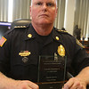 Tewksbury police chief Tim Sheehan, with the Commonwealth of Massachusetts Department of Mental Health's Exemplary Performance in Law Enforcement Award received for the department's handling of opioid and mental health calls. (SUN/Julia Malakie)