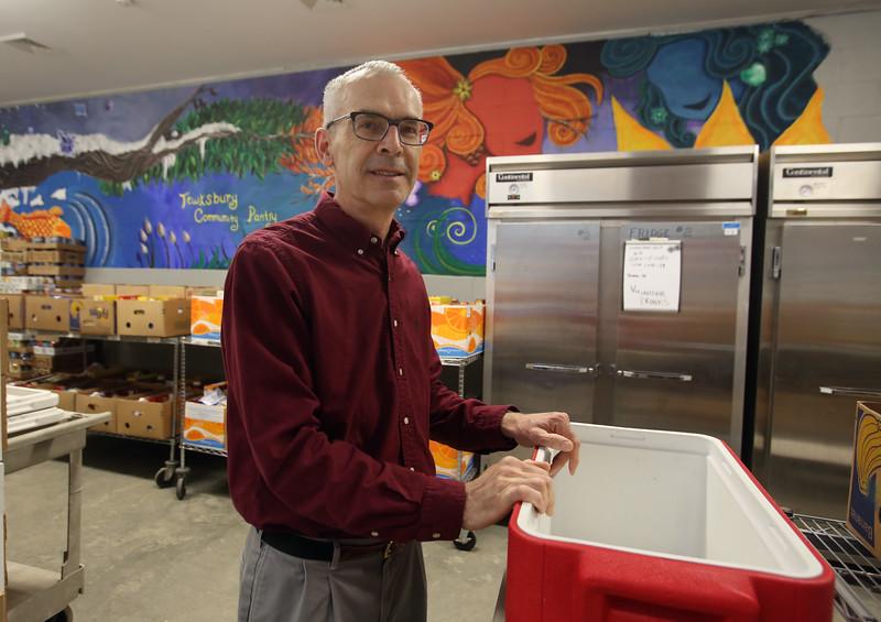 Ray Bowden of Tewksbury, at the Tewksbury Community Pantry food pantry where he volunteers. (SUN/Julia Malakie)