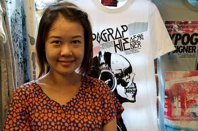 T-shirt vendor at the Chatuchak Sunday market in Bangkok.
