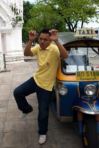 Tuk tuk driver shows off muay thai skills.