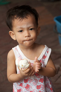 This young ice cream lover pauses to offer me a wai (traditional bow) for taking his photo.
