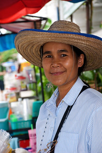 Chiang Mai vendor outside of a wat (temple) selling gift baskets for people to donate and make merit.