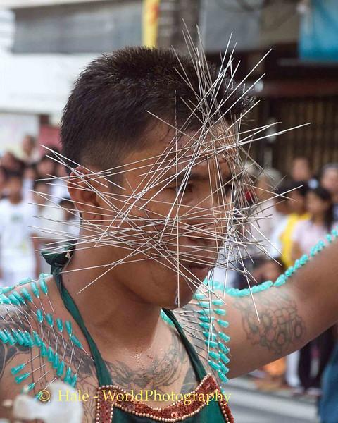 Mar Song's Face Pierced by Needles, Phuket Vegetarian Festival, Thailand
