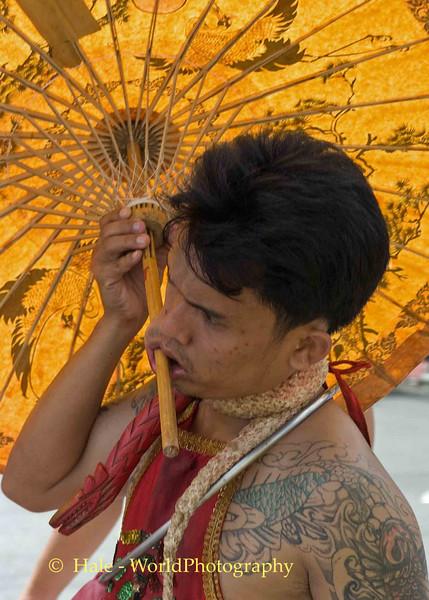 Mar Song Pierced by Umbrella, Phuket Vegetarian Festival, Thailand