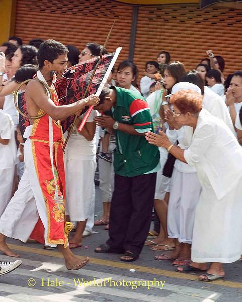 Receiving Blessings from Mar Song, Phuket Vegetarian Festival, Thailand