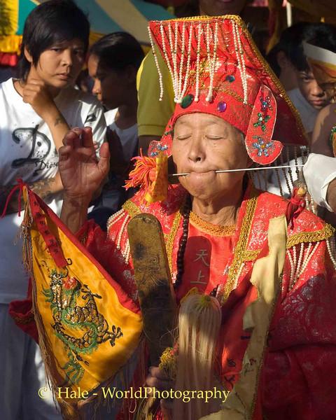 Elderly Female Mar Song Pierced by Rod, Phuket Vegetarian Festival, Thailand