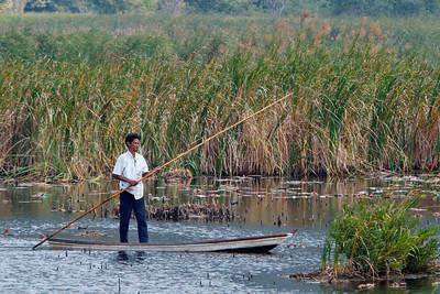 Park worker? Thung Sam Roi Yot, the marsh at Khao Sam Roi Yot National Park, Thailand.