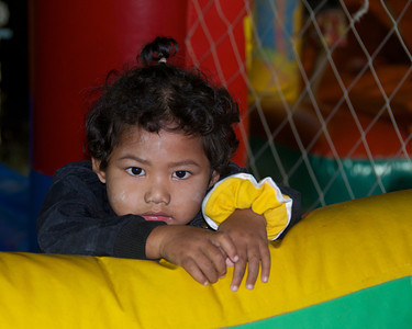 Taking a rest from the bouncy castle at a Wat (temple) festival. Sam Roi Yot Beach, Thailand