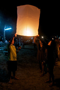 Letting go of a giant candle on New Year's Eve. It was amazing to watch them soar up from the beach and pass in front of the moon, then somewhat disturbing to wonder if they were causing fires when they landed. Sam Roi Yot Beach, Thailand