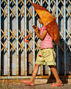 Shelter from the sun on the Mon, an ethnic group from Burma, side of the village. Sangklaburi, Thailand