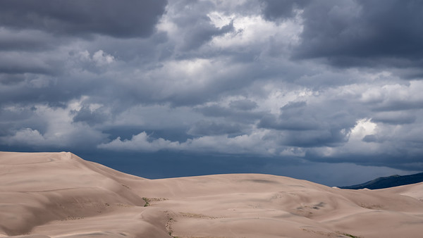 The dark clouds thickened and provided even more contrast to the sand dunes