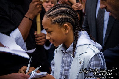 Jaden writing autographs.
