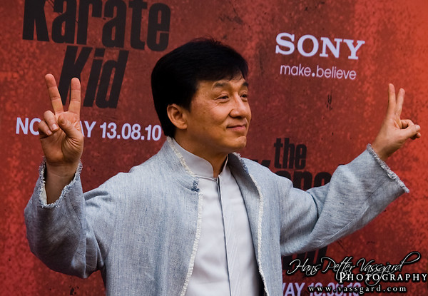 Jackie Chan posing for the photographers.
