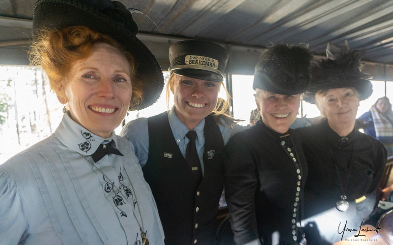 Kylah (brakeman) flanked by Historic Narrators Carrie, Susan and Gay