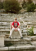 Me sitting in a greek stadium.  My father snapped this shot of me in the summer of 1967.  I am either below the Acropolis in Athens or a similar stadium in Delphi.  I have found three old pictures of me from this trip and I am wearing the same red shirt in all of them.