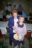 Helen with her great-grandmother Hazel at a reception after Gert's funeral. We were passing through Montana on a vacation and during our stay, my grandfather Gert suddenly died. This delayed our return and left an indelible impression in everyone's mind. I was off photography at the time and snapped this picture with an old Ph.D., (Push Here Dummy), film camera that embossed dates on the emulsion. Many of my favorite kid shots were taken with this crummy camera. In the long run content trumps image quality.