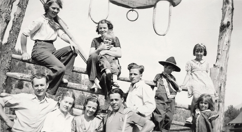 One of my grandmother's snapshots of family and friends literally hanging out on a fence. My grandmother is holding my mother on the top rail. Montana around 1937.