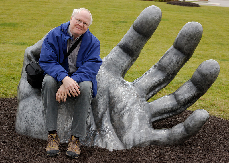 Me on the Chestefield giant's hand. This is what a post-ginger looks like. My reddish blond hair is almost all bleached but white hair is better than no hair!