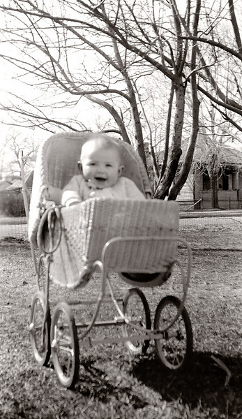 My mother in her baby pram days.