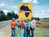 My sister Aileen (blue hat sunglasses), beside my mother Evelyn (sunglasses center), and my brother Steve (blue t-shirt), on the equator in Kenya during a 1976 safari trip. I don't know the other three people in the picture.