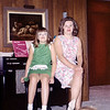 Aileen in a green dress with my mother in 1967. Probably taken in one of Margo's apartments, (Margo was one of my grandmother Helen's sisters), she was the only one that would have had an illuminated painting of sheep on the wall.