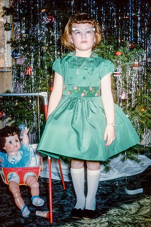 Aileen rocking a green Christmas dress in 1961.