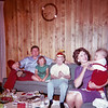 An early 1963 snapshot of my entire nuclear family. From left to right we have my dad Frank, my sister Aileen in a green dress, me with my propellor headgear and then my mother holding my toddler brother Steve.