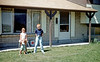 Steve, baby holding the hose, Aileen and myself in our Salt Lake City front yard in 1962. I don't remember a lot from this period. I do remember getting my first camera which I am wearing around my neck in this picture. I still wear cameras so at least that hasn't changed. I also recall that there was an alfalfa field behind our backyard. I had the worst allergies of my life because of that damn field. Nobody in our family remembers exactly where in Salt Lake this house was located.<br /> <br /> P.S. Recently we found a box of letters my grandmother Hazel saved. Hazel was a hoarder. It's not surprising that she saved all the letters addressed to her. What's surprising is that anyone found them. My mother stashed the letters away and I came across them a few days ago. They are mostly from my mother to Hazel with the earliest letter written when my mother was an eight-year-old child. Anyway, among all these letters I found some sent from Salt Lake City in the early 1960s. The envelope return address pinpoints this house at 1383 East 5935 South, Salt Lake City, UT.