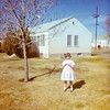 My sister Aileen standing in front of the small Redwash Utah oilfield camp house we lived in during the early 1960s. For years I had only a small crummy black and white print of this house. Then, this summer, I went through my paternal grandmother Helen's albums for the first time. Helen's pictures were neatly stashed in unlabeled cardboard boxes and hidden away for decades. I am pretty sure I was the first person to look at them in thirty years. Among Helen's photos were a series of Instamatic color prints taken around Redwash. Helen took good care of her pictures. The prints are in excellent condition and like most Kodak prints of that time the borders had dates. This print was made in April 1963.